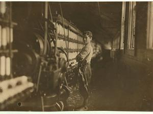 11 or 12 years old Saturday worker in the mule-spinning room at Jackson Mill, Fiskeville, RI by Lewis Wickes Hine