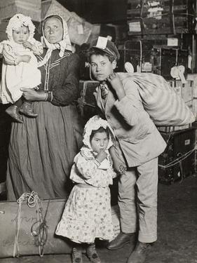 Italian Family Seeking Lost Baggage, Ellis Island, 1905 by Lewis Wickes Hine