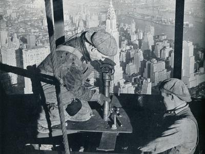 'Rivetting the last bolts on The Morning Mast of the Empire State building', c1931