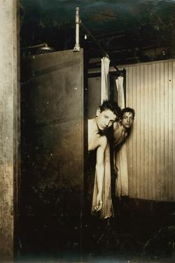 Telegraph boys using shower baths, Postal Tel. Co., Broadway, New York, 1910 by Lewis Wickes Hine
