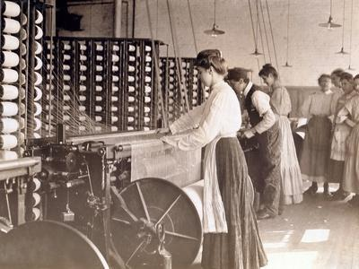 Young Women Working at a Spinning Machine in a Cotton Mill, South Carolina, 1908