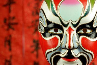 Beijing Opera Masks on a Festive Background. by Liang Zhang
