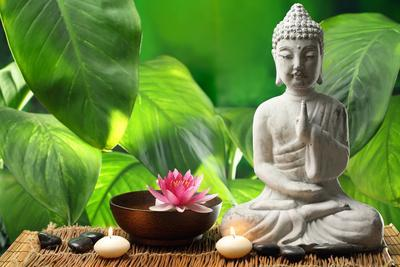 Buddha in Meditation with Lotus Flower and Burning Candles