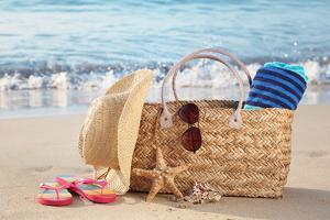 Summer Beach Bag with Straw Hat,Towel,Sunglasses and Flip Flops on Sandy Beach by Liang Zhang