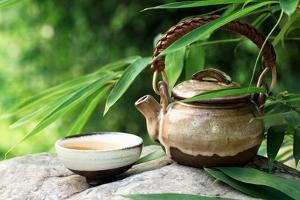 Teapot and Cups on Stone with Bamboo Leaves. by Liang Zhang