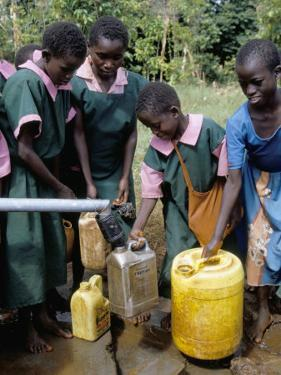 School Children at Water Pump, Kenya, East Africa, Africa by Liba Taylor