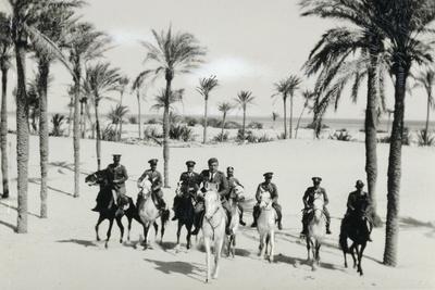https://imgc.allpostersimages.com/img/posters/libya-horseback-patrol-of-italian-financiers-in-oasis-1935_u-L-PRLF5P0.jpg?p=0