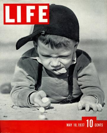 LIFE Boy playing marbles 1937