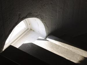 Light Through Window on Concrete Staircase Indoors