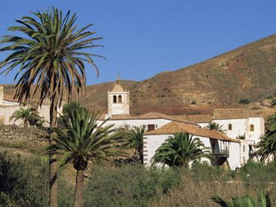 Palm Trees, Houses and Church at Betancuria, on Fuerteventura in the Canary Islands, Spain, Europe