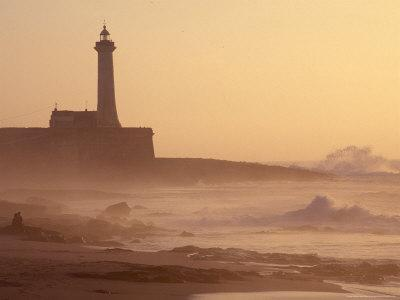 https://imgc.allpostersimages.com/img/posters/lighthouse-at-sunset-with-crashing-waves-morocco_u-L-P586QC0.jpg?p=0