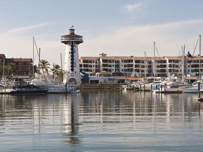 https://imgc.allpostersimages.com/img/posters/lighthouse-in-marina-vallarta-puerto-vallarta-mexico_u-L-PHASZ70.jpg?p=0