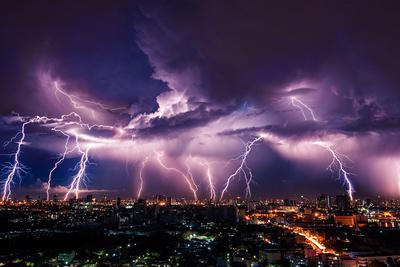 https://imgc.allpostersimages.com/img/posters/lightning-storm-over-city-in-purple-light_u-L-Q1A29KK0.jpg?p=0