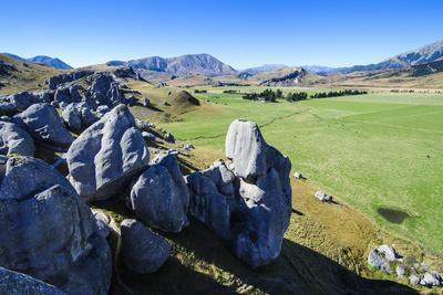 https://imgc.allpostersimages.com/img/posters/limestone-outcrops-on-castle-hill-canterbury-south-island-new-zealand-pacific_u-L-PQ8MQB0.jpg?p=0