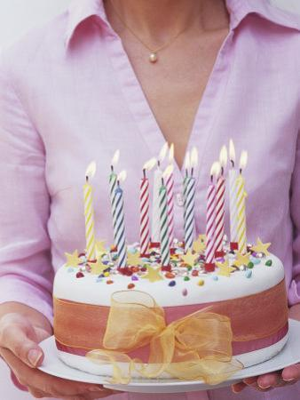 Birthday Cake with Burning Candles by Linda Burgess