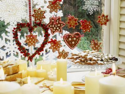 Christmassy Window Decorated with Biscuits and Candles by Linda Burgess
