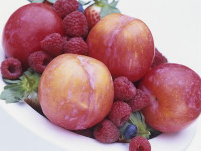 Fruit Bowl with Red Plums and Raspberries by Linda Burgess