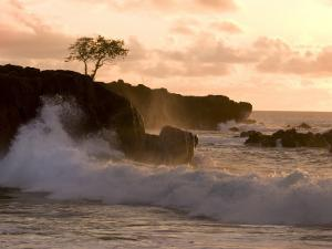 Sunset at Waimea Bay, with Waves Crashing Against Rocks by Linda Ching