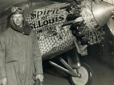 https://imgc.allpostersimages.com/img/posters/lindbergh-with-his-airplane-1928_u-L-Q1HOCRK0.jpg?artPerspective=n