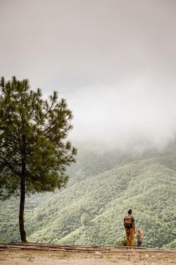 A Father And Daughter Take In The Beauty In The Nepal Mountains by Lindsay Daniels