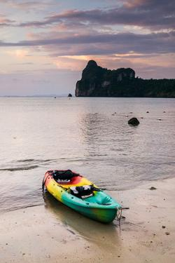 A Kayak On The Shore Of Phi Phi Island At Sunset by Lindsay Daniels