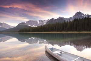 Canoe and Mountain Reflection in Waterfowl Lakes, Alberta, Canada by Lindsay Daniels