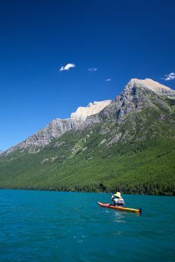 Kayaker At Glacier National Park. Bow Lake. by Lindsay Daniels