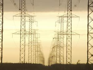 Line of High Tension Electrical Towers at Dusk