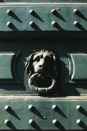 https://imgc.allpostersimages.com/img/posters/lion-head-detail-from-main-entrance-of-palazzo-belgioioso-milan-lombardy-italy_u-L-POPTR40.jpg?p=0