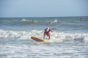 Surfing Santas, Cocoa Beach, Florida, USA by Lisa Engelbrecht