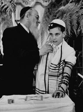 Rabbi David S. Novoseller Adjusting Carl Jay Bodek's Robe During Ceremony by Lisa Larsen
