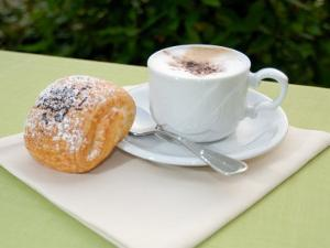 Morning Cappuccino at Eden Grand Hotel, Lake Lugano, Lugano, Switzerland by Lisa S. Engelbrecht