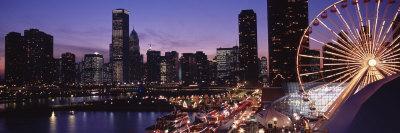 https://imgc.allpostersimages.com/img/posters/lit-up-ferris-wheel-at-dusk-navy-pier-chicago-illinois-usa_u-L-P18J510.jpg?p=0
