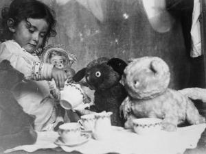 Little Girl Hosts a Tea Party, Three Bears and a Doll Attend