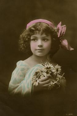Little Girl in Pink, Blue and White with Flowers