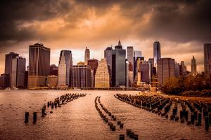 New York City View of Lower Manhattan Financial District under Dramatic Sky from across East River by Littleny