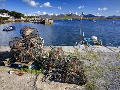 https://imgc.allpostersimages.com/img/posters/lobster-pots-at-roundstone-harbour-connemara-county-galway-connacht-republic-of-ireland-europe_u-L-PFNOM80.jpg?p=0