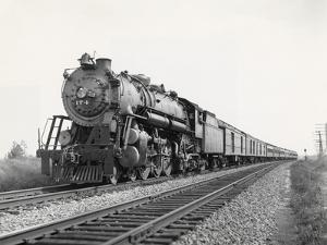 Locomotive Train Moving down Tracks