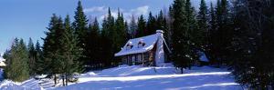 Log House in Winter Laurentides Quebec Canada