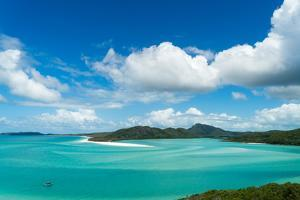 A boat in the shallow water of Whitsunday Island in tropical Queensland, Australia, Pacific by Logan Brown