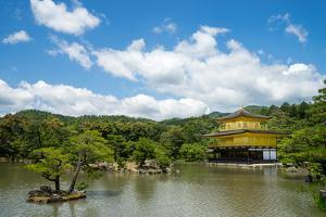 A peaceful lake in front of the golden pavilion of Kinkaku-ji in Kyoto, Japan, Asia by Logan Brown