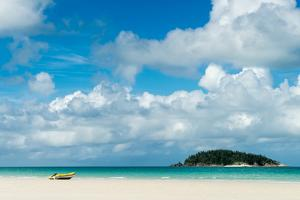 A small dinghy sits on the white sand of Whitehaven Beach, Whitsunday Island, Australia, Pacific by Logan Brown
