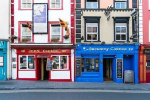 Colorful building fronts of traditional beer pubs in Kilkenny, County Kilkenny, Leinster, Ireland by Logan Brown