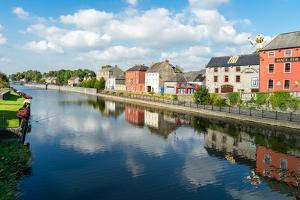 Homes line a canal in Kilkenny, County Kilkenny, Leinster, Republic of Ireland, Europe by Logan Brown