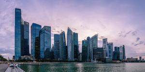 Skyscrapes line Marina Bay at dusk, Singapore, Southeast Asia, Asia by Logan Brown