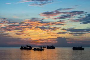 Sun sets over scuba diving boats in Koh Tao, Thailand, Southeast Asia, Asia by Logan Brown