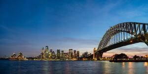 Sydney's iconic buildings lit up as dusk settles over the city, Sydney, New South Wales, Australia by Logan Brown