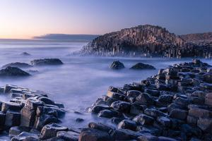 The Giant's Causeway rises out of the Atlantic, Northern Ireland by Logan Brown