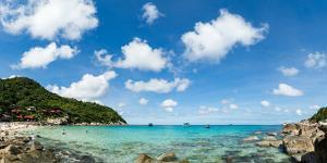 Toursits enjoy the clear water and sun at a beach on the Thai island of Koh Tao, Thailand by Logan Brown