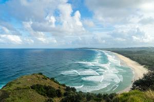 Waves as far as the eye can see along the coast of Byron Bay, New South Wales, Australia, Pacific by Logan Brown